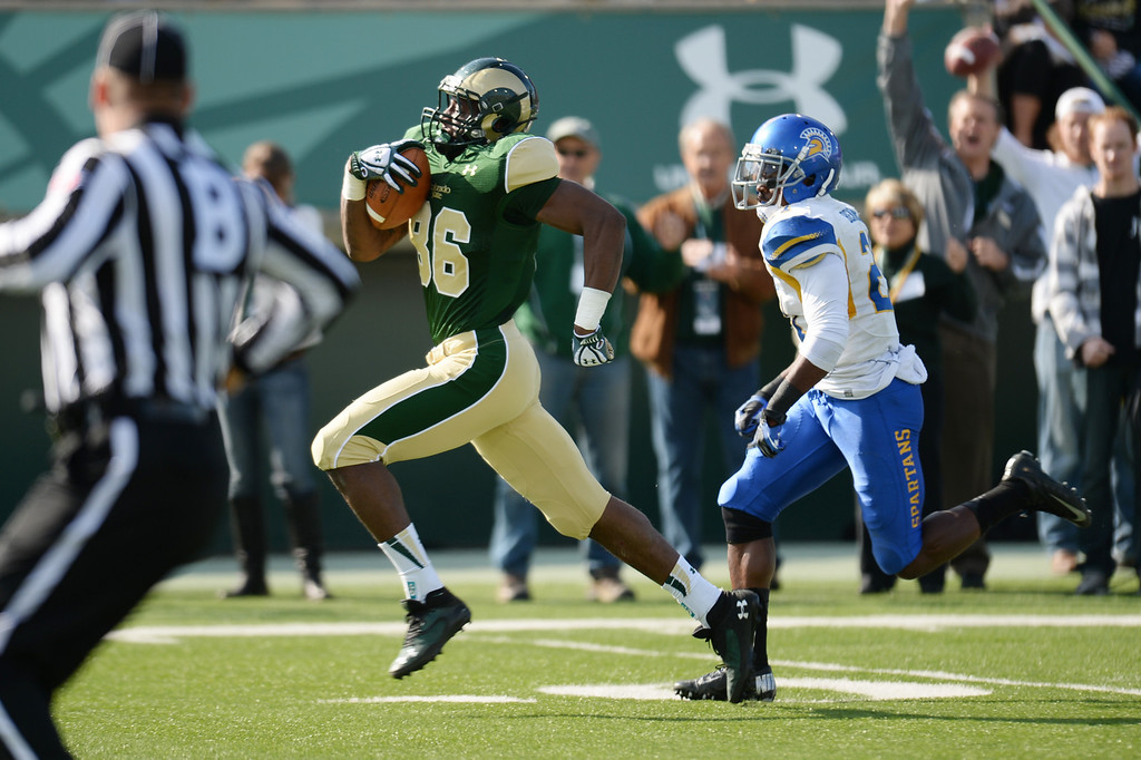 . FORT COLLINS, CO - OCTOBER 12 : Kivon Cartwright of Colorado State (86) passes Bene Benwikere of San Jose State (21), heading for a touchdown in the 1st quarter of the game at Hughes Stadium. Fort Collins. Colorado. October 12, 2013. San Jose won 34-27. (Photo by Hyoung Chang/The Denver Post)
