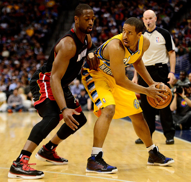 . Dwyane Wade (3) of the Miami Heat defends Andre Miller (24) of the Denver Nuggets during the first half of action.  (Photo by AAron Ontiveroz/The Denver Post)