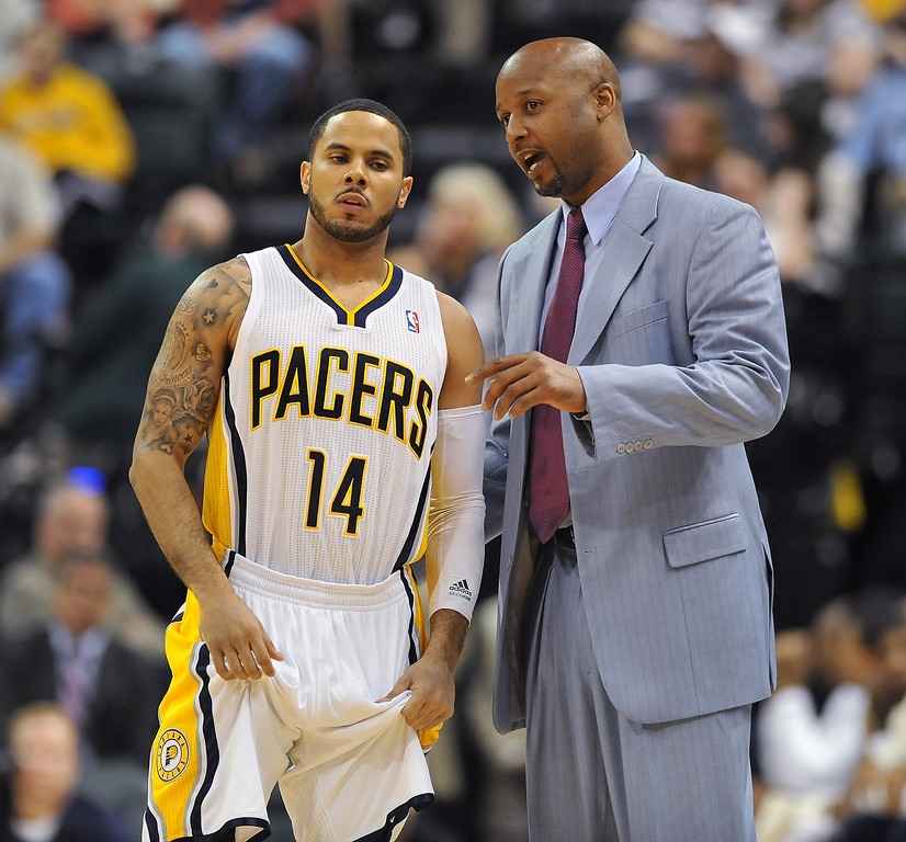 . Indiana assistant coach Brian Shaw talks to Pacer D. J. Augustine after head coach Frank Vogel was ejected from the game in the third quarter against the Cleveland Cavaliers on April 9, 2013.   (Joe Vitti / The Indianapolis Star)