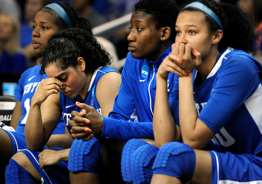 . Kentucky\'s DeNesha Stallworth, from left, Jennifer O\'Neill, Brittany Henderson and Azia Bishop react during the final minutes of their regional final game against Connecticut in the women\'s NCAA college basketball tournament in Bridgeport, Conn., Monday, April 1, 2013. Connecticut won 83-53. (AP Photo/Jessica Hill)