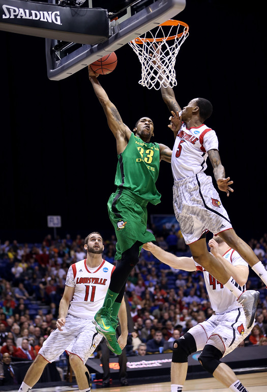 . Carlos Emory #33 of the Oregon Ducks misses a dunk attempt in the first half against Kevin Ware #5 of the Louisville Cardinals during the Midwest Region Semifinal round of the 2013 NCAA Men\'s Basketball Tournament at Lucas Oil Stadium on March 29, 2013 in Indianapolis, Indiana.  (Photo by Streeter Lecka/Getty Images)