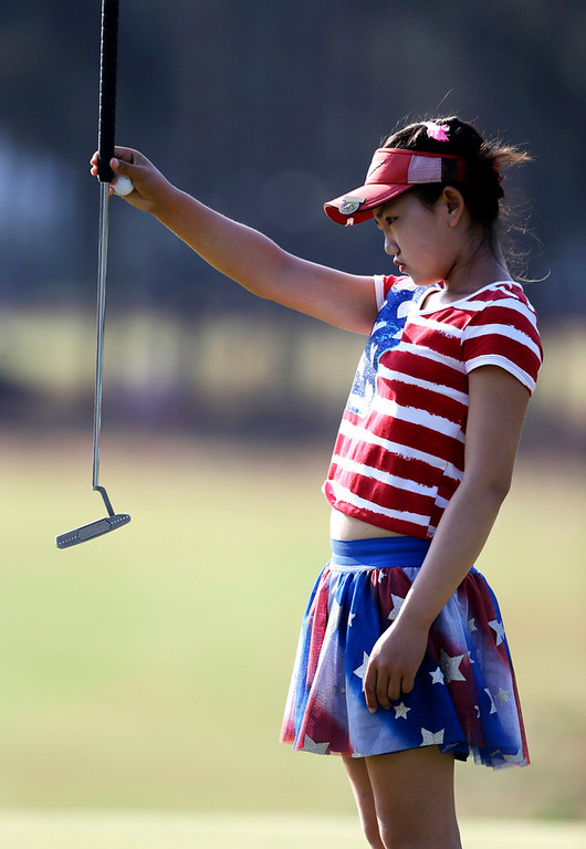 . Lucy Li lines up a putt on the 13th hole during the first round of the U.S. Women\'s Open golf tournament in Pinehurst, N.C., Thursday, June 19, 2014. (AP Photo/Bob Leverone)