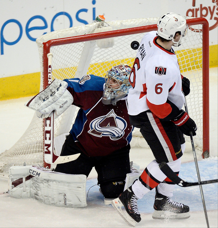 . Colorado Avalanche goalie Semyon Varlamov (1) watches the puck sail over his head asOttawa Senators right wing Bobby Ryan (6) looks on during the second period January 8, 2014 at Pepsi Center. (Photo by John Leyba/The Denver Post)