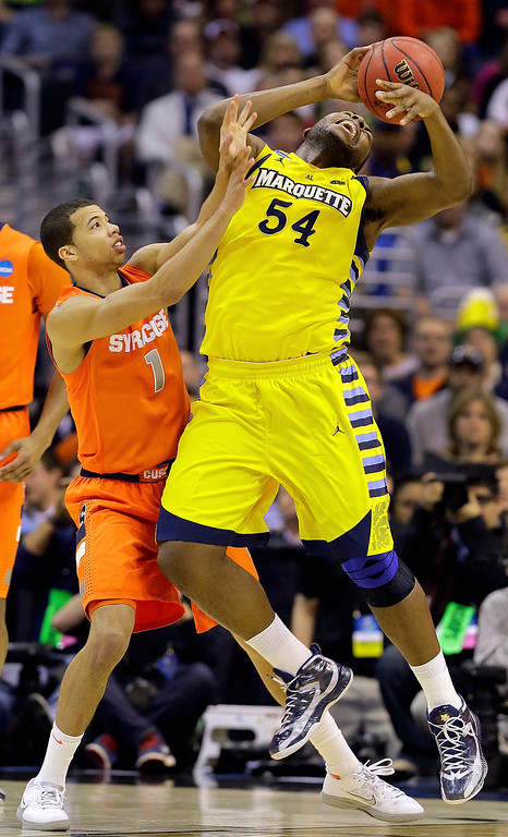 . Marquette forward Davante Gardner (54) loses control of the ball under pressure from Syracuse guard Michael Carter-Williams (1) during the first half of the East Regional final in the NCAA men\'s college basketball tournament, Saturday, March 30, 2013, in Washington. (AP Photo/Alex Brandon)