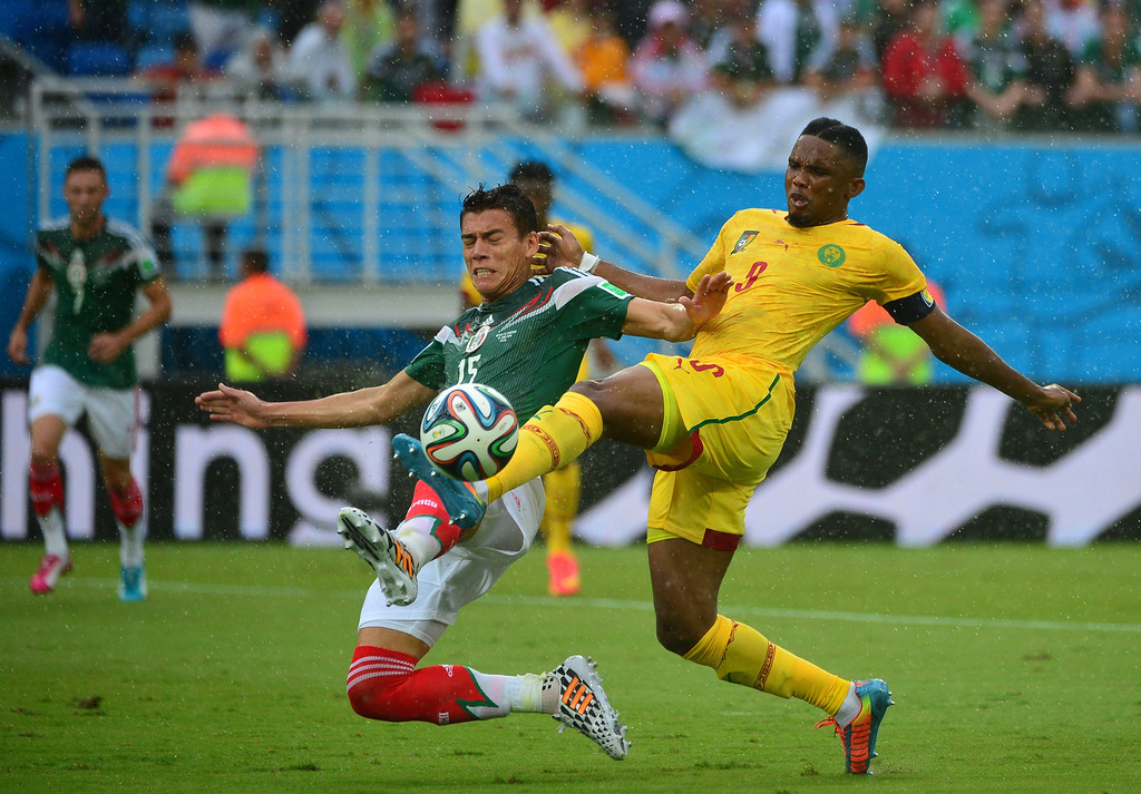 . Mexico\'s defender Hector Moreno (L) challenges Cameroon\'s forward Samuel Eto\'o during the Group A football match between Mexico and Cameroon at the Dunas Arena in Natal during the 2014 FIFA World Cup on June 13, 2014. YURI CORTEZ/AFP/Getty Images