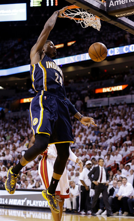 . Indiana Pacers forward Paul George (24) dunks the ball during the first half of Game 4 in the NBA basketball Eastern Conference finals playoff series against the Miami Heat, Monday, May 26, 2014, in Miami. (AP Photo/Wilfredo Lee)