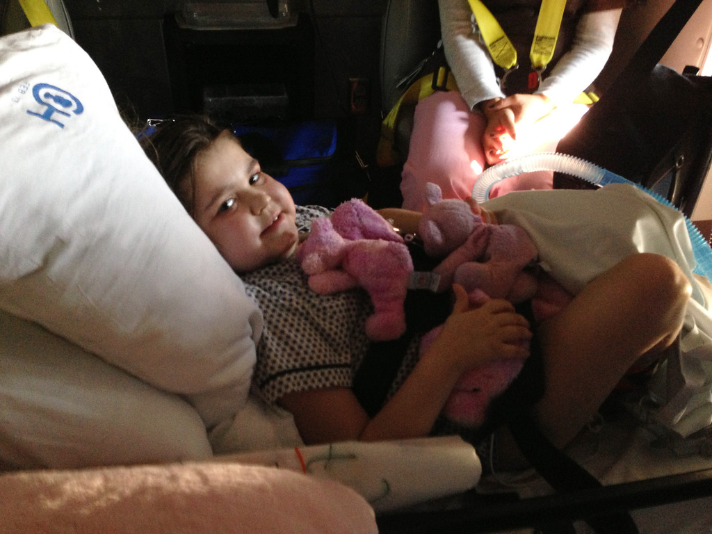 . In this photo provided by the Murnaghan family, Sarah Murnaghan sits in an ambulance, in Philadelphia Tuesday, Aug. 27, 2013 waiting to be taken home. The Pennsylvania girl whose need for new lungs sparked a national debate on how transplant recipients are prioritized was was discharged from The Children\'s Hospital of Philadelphia Tuesday. (AP Photo/Murnaghan family)
