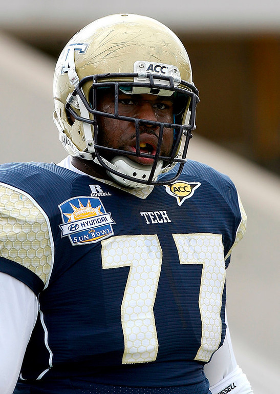 . Georgia Tech offensive guard Omoregie Uzzi appears before the Sun Bowl NCAA college football game against Southern California, Monday, Dec. 31, 2012, in El Paso, Texas. (AP Photo/Mark Lambie)