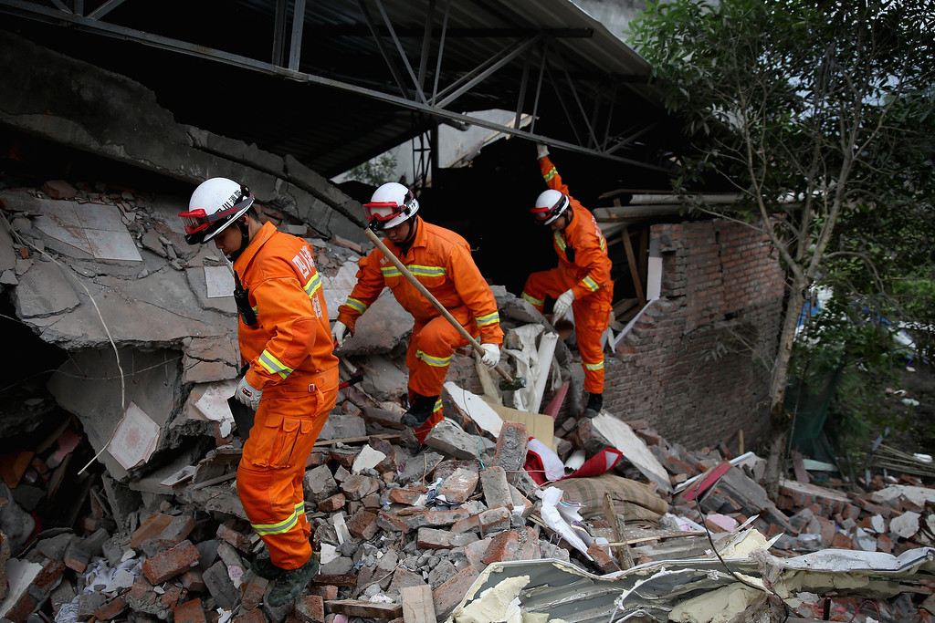 . Members of a rescue team look for the earthquake survivors on April 22, 2013 in Baoxing county of Ya An, China.  A magnitude 7 earthquake hit China\'s Sichuan province on April 20 claiming over 190 lives and injuring thousands.  (Photo by Feng Li/Getty Images)