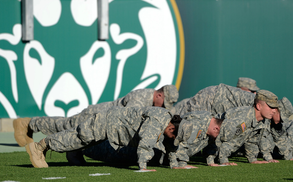 . The Colorado State Army ROTC had plenty of push ups to do at Saturday\'s game against Air Force at Hughes Stadium afternoon, November 30, 2013. The Rams won 58-13. (Photo By Andy Cross/The Denver Post)