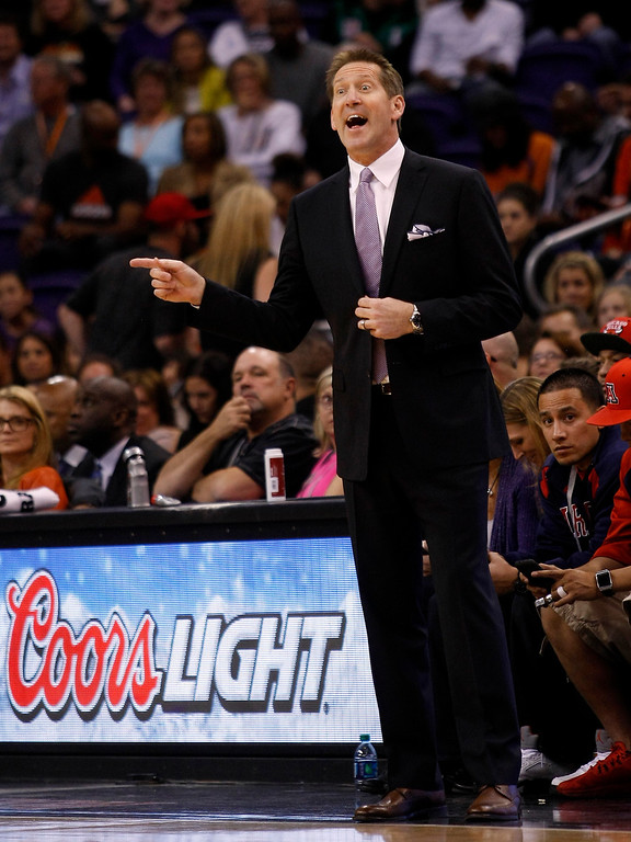 . Phoenix Suns head coach Jeff Hornacek calls out a play in the first quarter during an NBA basketball game against the Denver Nuggets, Sunday, Jan. 19, 2014, in Phoenix. (AP Photo/Rick Scuteri)