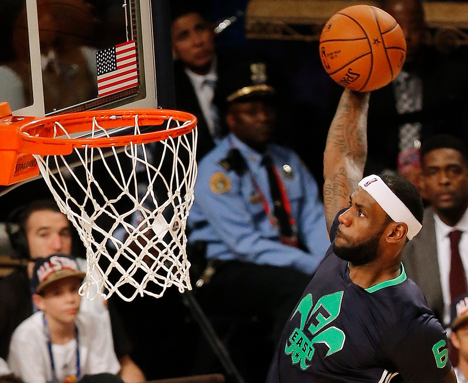 . East Team\'s LeBron James, of the Miami Heat (6) heads to the hoop during the NBA All Star basketball game, Sunday, Feb. 16, 2014, in New Orleans. (AP Photo/Bill Haber)