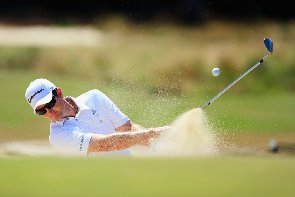 . PINEHURST, NC - JUNE 15: Justin Rose of England hits his second shot from a bunker on the third hole during the final round of the 114th U.S. Open at Pinehurst Resort & Country Club, Course No. 2 on June 15, 2014 in Pinehurst, North Carolina.  (Photo by David Cannon/Getty Images)