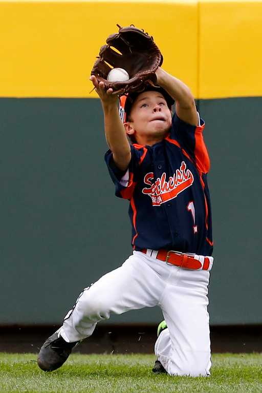 . Tennessee center fielder Eston Snider (1) catches a sacrifice fly to deep center by Pennsylvania\'s Carter Davis that scored Zion Spearman during the fifth inning of a baseball game in United States pool play at the Little League World Series tournament in South Williamsport, Pa., Friday, Aug. 15, 2014. Pennsylvania won 4-0.(AP Photo/Gene J. Puskar)
