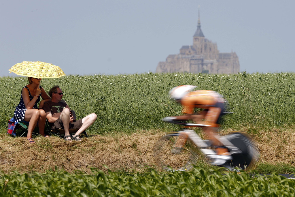 . A Spanish Euskaltel-Euskadi cycling team rider competes riding past spectators along the road during the 33 km individual time-trial and eleventh stage of the 100th edition of the Tour de France cycling race on July 10, 2013between Avranches and Mont-Saint-Michel, northwestern France.   JOEL SAGET/AFP/Getty Images