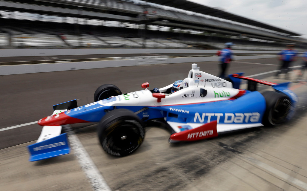 . Ryan Briscoe, of Australia, pulls out of the pit area during practice for the Indianapolis 500 auto race at the Indianapolis Motor Speedway in Indianapolis, Thursday, May 16, 2013. (AP Photo/Darron Cummings)