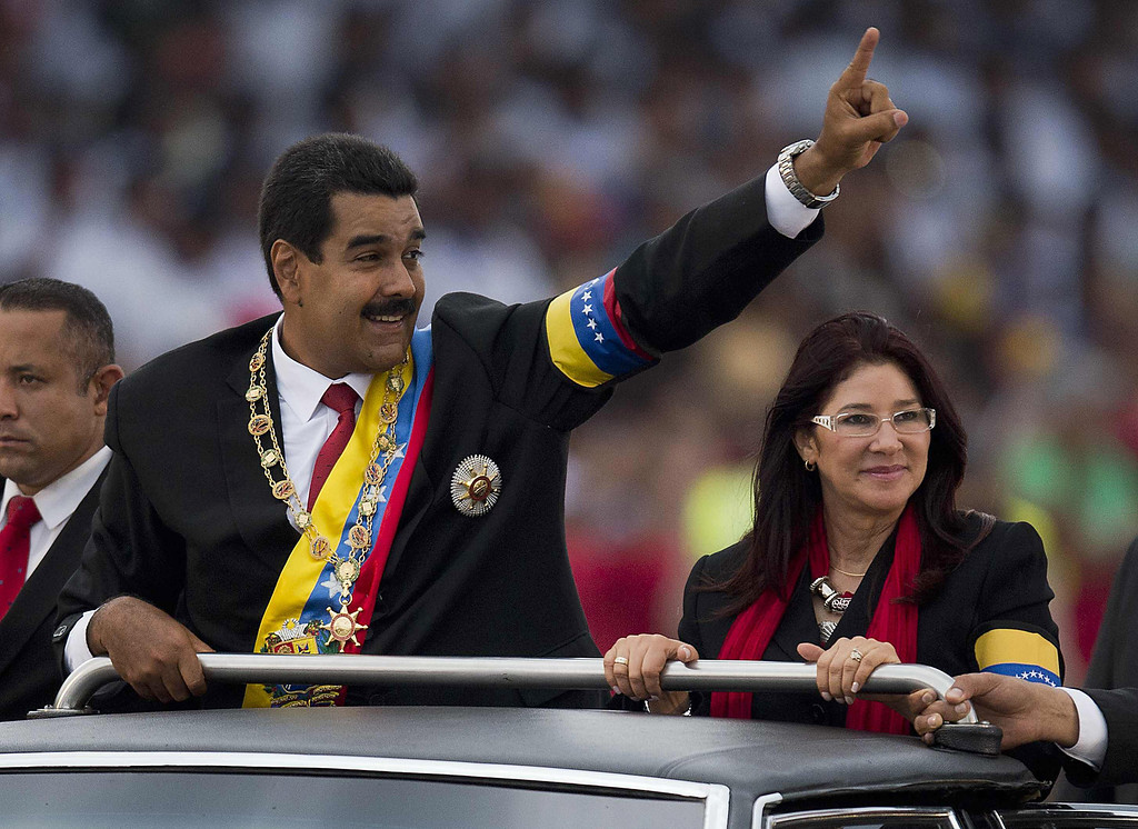 . Venezuelan President Nicolas Maduro waves to the crowd during a motorcade after his installation in Caracas on April 19, 2013.  LUIS ACOSTA/AFP/Getty Images