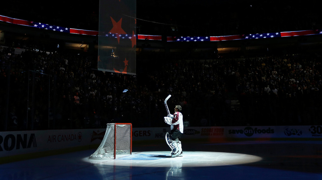 . Colorado Avalanche goalie Semyon Varlamov stands for national anthems before their NHL hockey game against the Vancouver Canucks in Vancouver, British Columbia March 28, 2013.   REUTERS/Andy Clark
