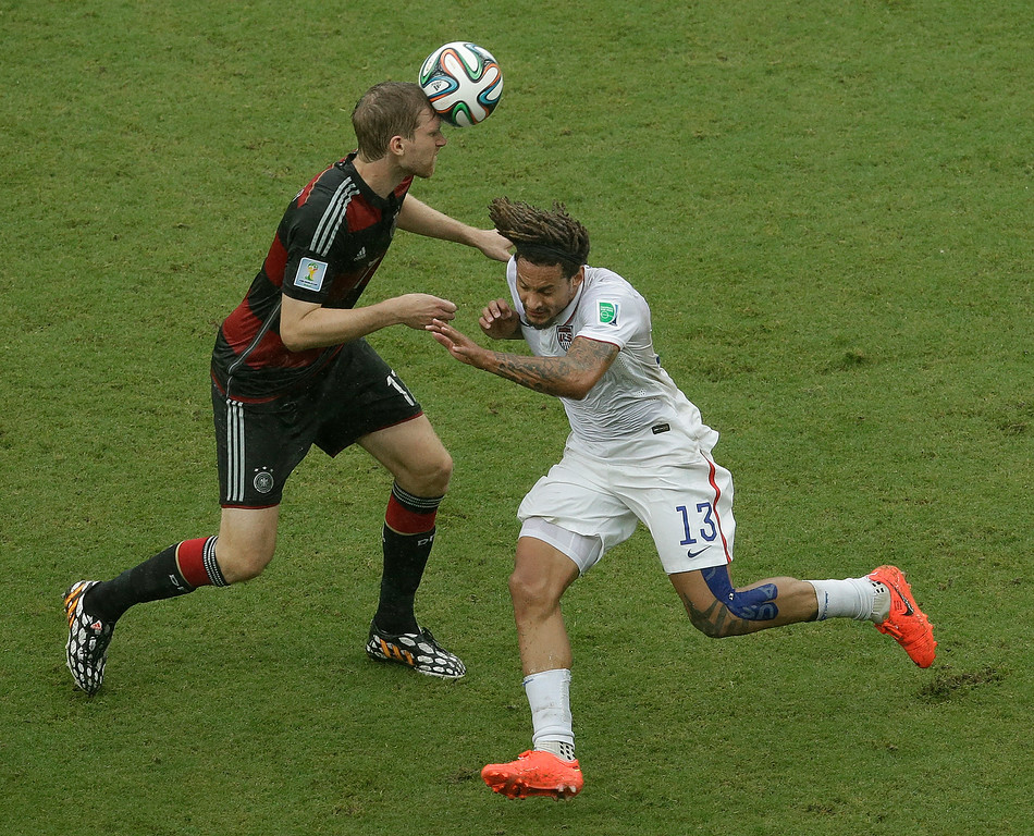 . Germany\'s Per Mertesacker heads the ball past United States\' Jermaine Jones (13) during the group G World Cup soccer match between the USA and Germany at the Arena Pernambuco in Recife, Brazil, Thursday, June 26, 2014. (AP Photo/Hassan Ammar)
