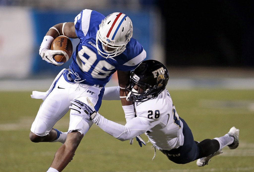 . Middle Tennessee wide receiver Devin Clarke (86) gets past Florida International safety Deonte Wilson (28) as Clarke gains 30 yards on a pass in the fourth quarter of an NCAA college football game on Saturday, Nov. 9, 2013, in Murfreesboro, Tenn. Middle Tennessee won 48-0. (AP Photo/Mark Humphrey)
