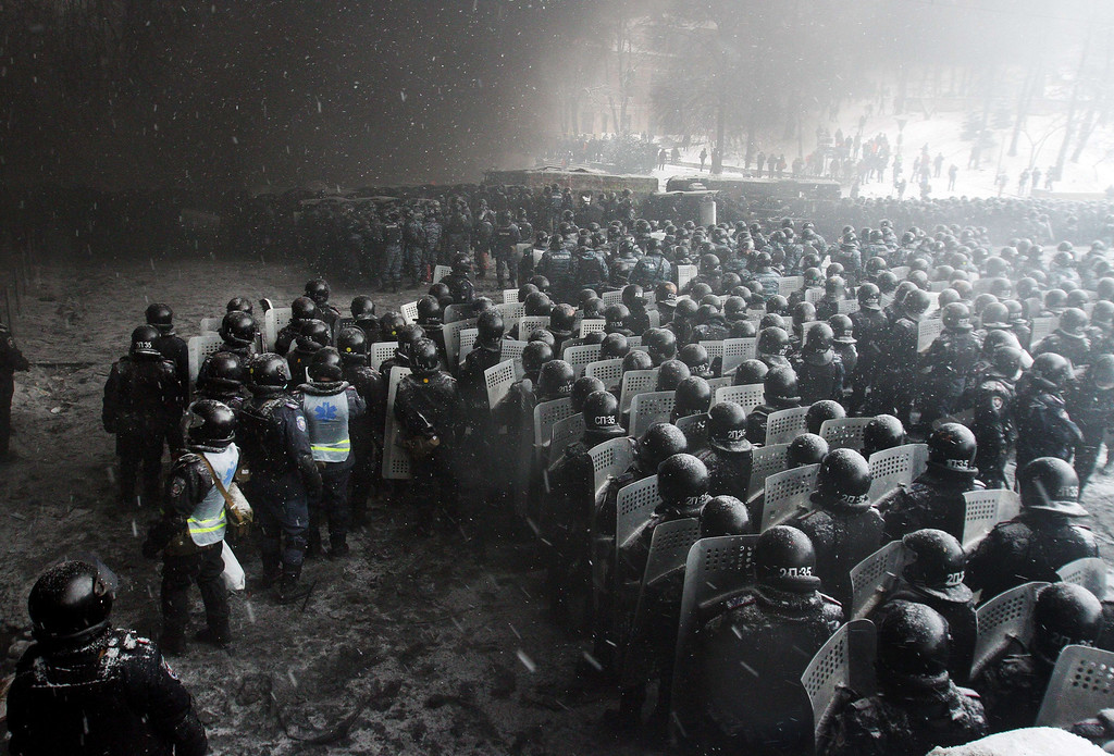. Riot police officers gather as they clash with protestors in the center of Kiev on January 22, 2014. Ukrainian police today stormed protesters\' barricades in Kiev as violent clashes erupted and activists said that one person had been shot dead by the security forces.  AFP PHOTO/ ANATOLII BOIKO/AFP/Getty Images
