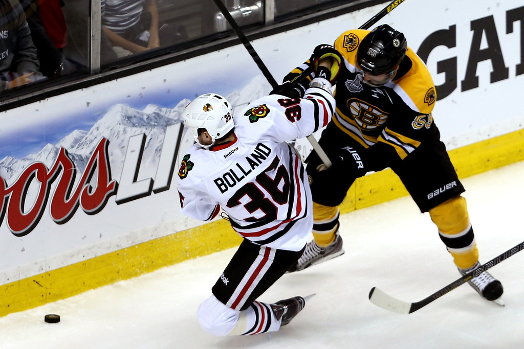 . Dave Bolland #36 of the Chicago Blackhawks falls to the ice against Johnny Boychuk #55 of the Boston Bruins during the first period in Game Four of the 2013 NHL Stanley Cup Final at TD Garden on June 19, 2013 in Boston, Massachusetts.  (Photo by Bruce Bennett/Getty Images)
