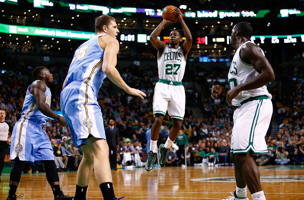. BOSTON, MA - DECEMBER 06: Jordan Crawford #27 of the Boston Celtics attempts a three point shot against the Denver Nuggets in the first quarter during the game at TD Garden on December 6, 2013 in Boston, Massachusetts.  (Photo by Jared Wickerham/Getty Images)