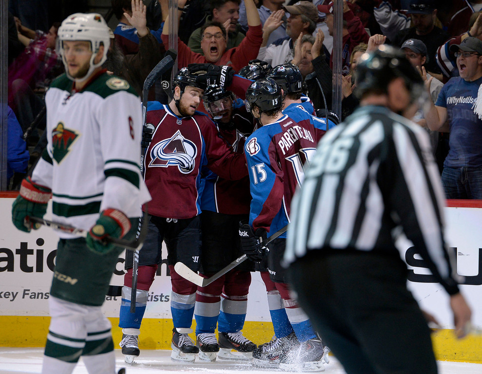 . Jamie McGinn (11) of the Colorado Avalanche celebrates with teammates after scoring goal number three for the Avalanche during the third period of action. The Colorado Avalanche hosted the Minnesota Wild for the first playoff game at the Pepsi Center on Thursday, April 17, 2014. (Photo by John Leyba/The Denver Post)