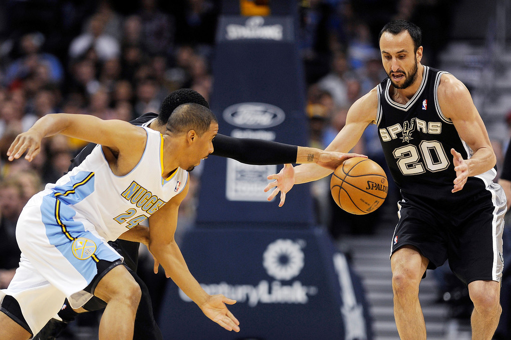 . Manu Ginobili #20 of the San Antonio Spurs goes after a ball with Andre Miller #24 of the Denver Nuggets in the first half at the Pepsi Center on November 5, 2013, in Denver, Colorado. (Photo by Daniel Petty/The Denver Post)