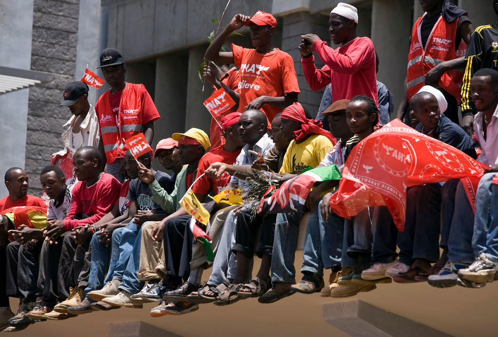 . Supporters of candidate Uhuru Kenyatta wait for him to show up and give a speech in Nairobi March 9, 2013. REUTERS/Siegfried Modola