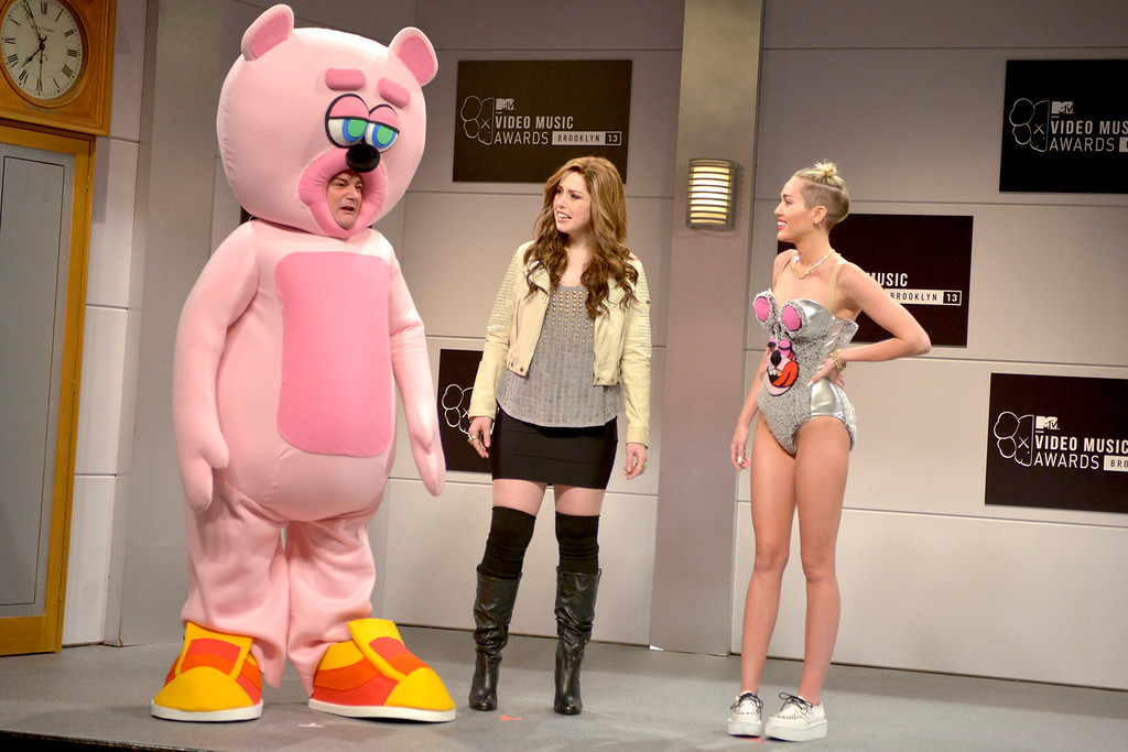 """. From left,  Bobby Moynihan, Vanessa Bayer and guest host Miley Cyrus in a scene from the late-night comedy series \""""Saturday Night Live,\"""" in New York on Oct. 5, 2013. (AP Photo/NBC, Dana Edelson)"""