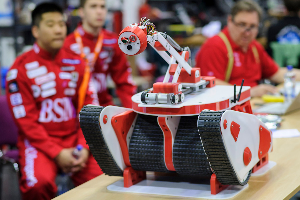 . Participants check a rescue robot at the 2014 RoboCup German Open tournament on April 03, 2014 in Magdeburg, Germany. 950 participants from 12 countries are participating in the the three-day tournament that compete in a variety of disciplines, including soccer, rescue and dance. (Photo by Jens Schlueter/Getty Images)