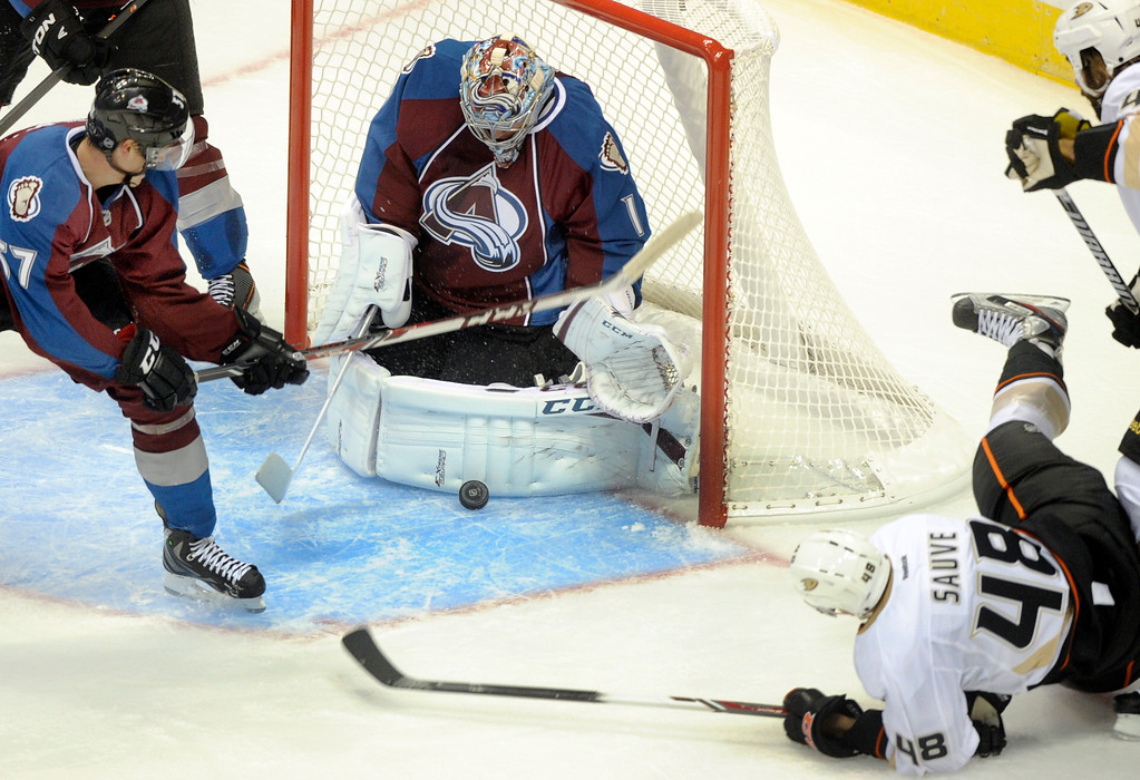 . Colorado goalie Semyon Varlamov (1) made a pad save on a wrap-around attempt by Anaheim forward Mazime Sauve (48) in the second period.  Photo By Karl Gehring/The Denver Post