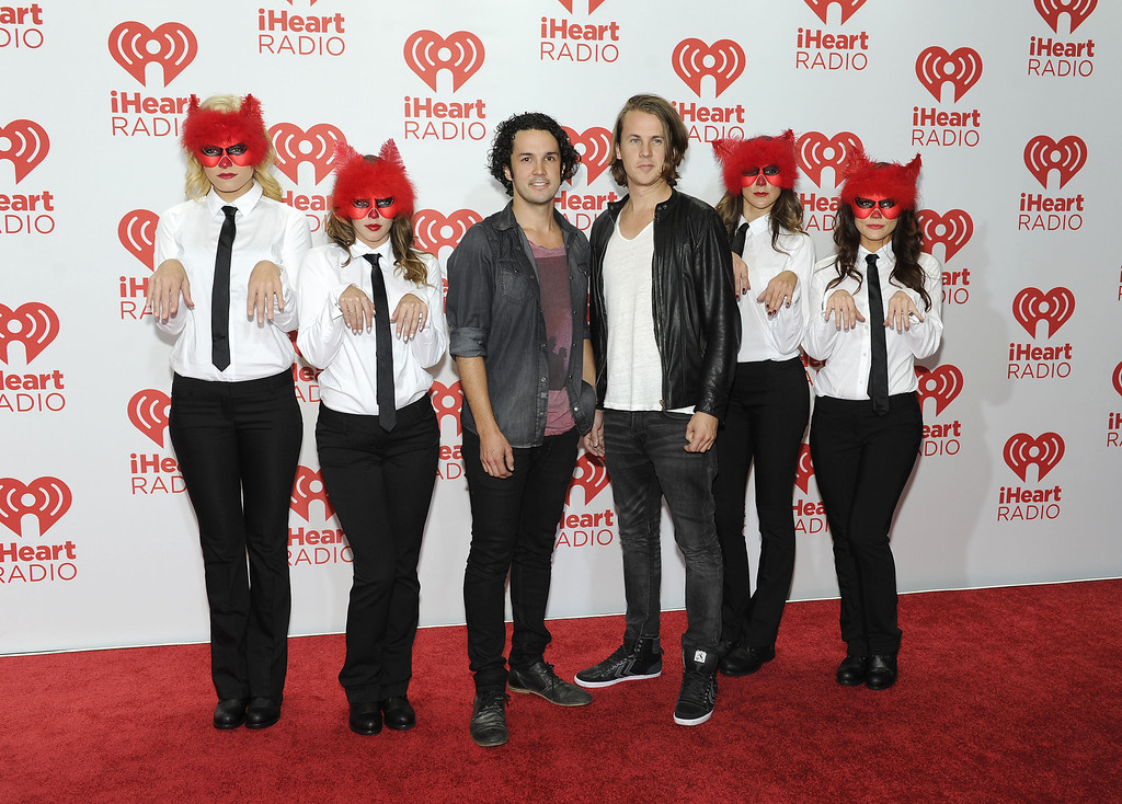 . Vegard Urheim Ylvisåker (L) and Bård Urheim of Ylvis attend the iHeartRadio Music Festival at the MGM Grand Garden Arena on September 20, 2013 in Las Vegas, Nevada.  (Photo by David Becker/Getty Images for Clear Channel)