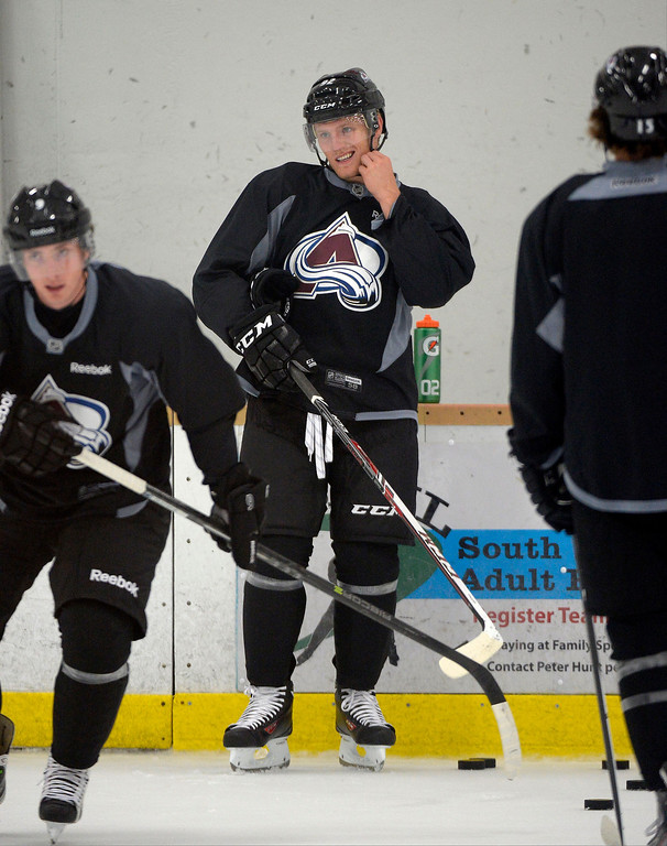 . Colorado Avalanche LW Gabriel Landeskog (92) snaps on his helmet during practice September 10, 2013 at Family Sports. (Photo By John Leyba/The Denver Post)