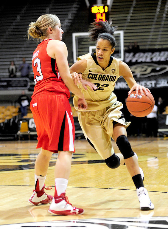 . Colorado\'s Arielle Roberson (right) fights past Utah\'s Rachel Messer (left) during their basketball game at the University of Colorado in Boulder , Colorado January 8, 2013. BOULDER DAILY CAMERA/ Mark Leffingwell