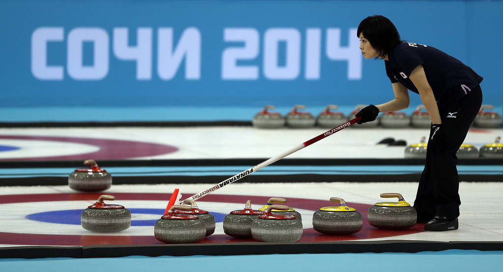 . Japan\'s Yumie Funayama lines up a stone during the Women\'s Curling Round Robin Session 11 Japan vs China at the Ice Cube Curling Center during the Sochi Winter Olympics on February 17, 2014 in Sochi. Japan won the game 8-5. ADRIAN DENNIS/AFP/Getty Images