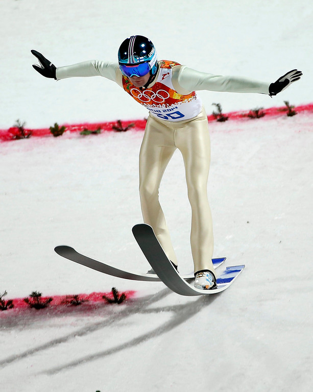 . Anssi Koivuranta of Finland in action during the Normal Hill Ski Jumping competition Gorki Jumping Center at the Sochi 2014 Olympic Games, Krasnaya Polyana, Russia, on Feb. 9, 2014.  EPA/VALDRIM XHEMAJ