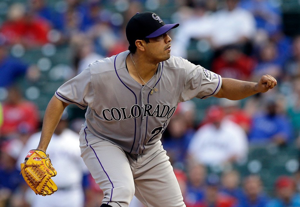 . Colorado Rockies\' Jorge De La Rosa follows through on his delivery to the Texas Rangers in the first inning of a baseball game, Wednesday, May 7, 2014, in Arlington, Texas. (AP Photo/Tony Gutierrez)