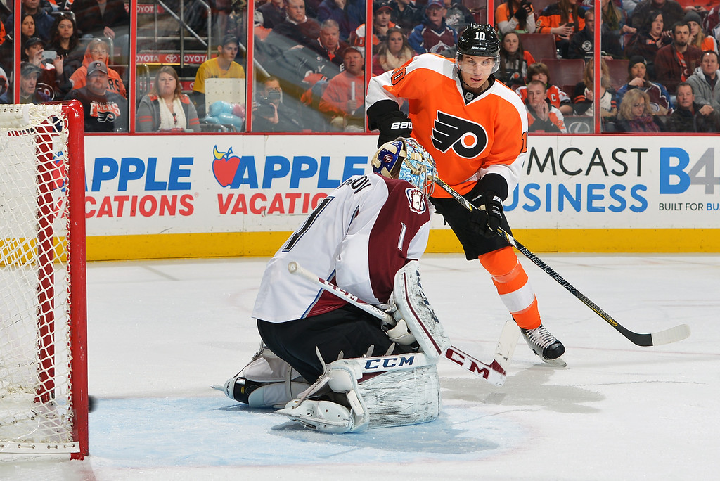 . PHILADELPHIA, PA - FEBRUARY 06: The puck crosses the goal line behind Semyon Varlamov #1 of the Colorado Avalanche in the second period, as Brayden Schenn #10 of the Philadelphia Flyers looks on at the Wells Fargo Center on February 6, 2014 in Philadelphia, Pennsylvania.  (Photo by Drew Hallowell/Getty Images)