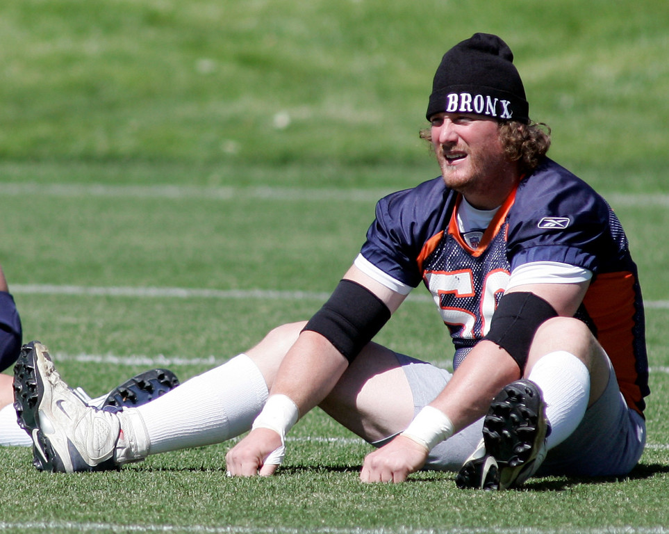 . Denver Broncos center Tom Nalen stretches during the last day of football mini-camp at Broncos headquarters in Denver, Thursday, June 7, 2007. (AP Photo/Jack Dempsey)