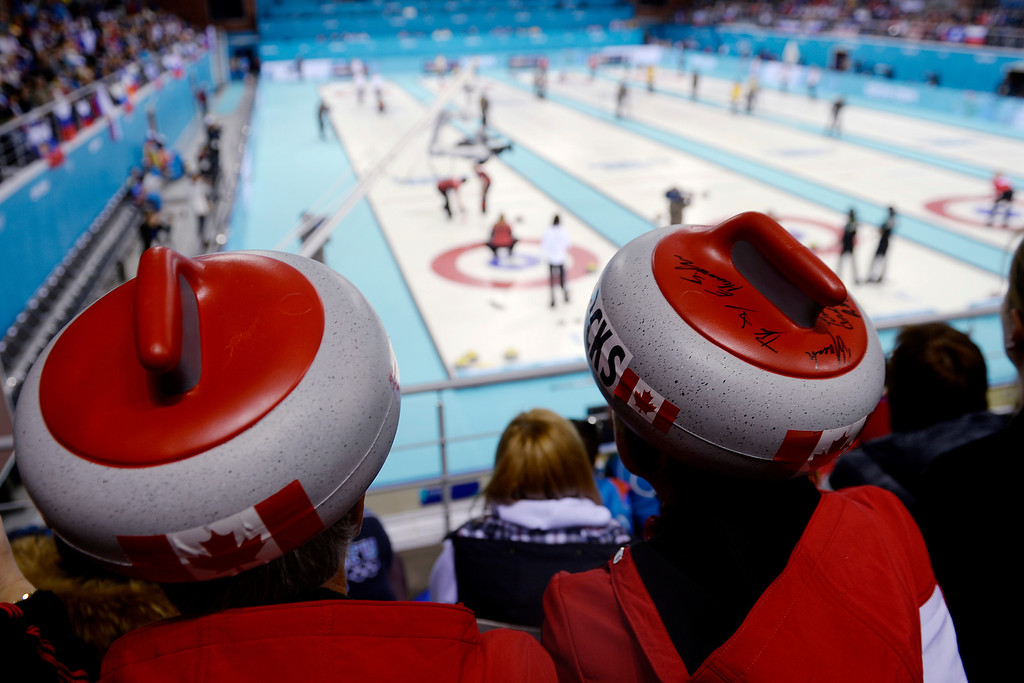 . David and Debbie Stone of Sault St. Marie, Ontario, Canada watch the action between Great Britain and Canada during a women\'s curling qualifier at the Ice Cube Curling Center. Sochi 2014 Winter Olympics on Wednesday, February 12, 2014. (Photo by AAron Ontiveroz/The Denver Post)