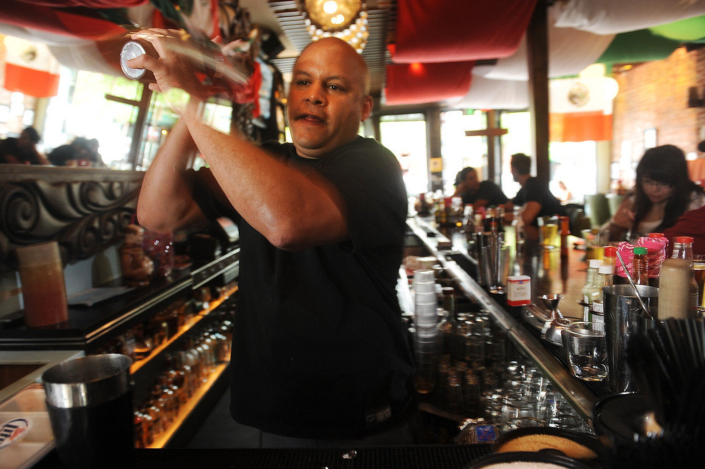 """. Bartender JJ  Ahern shakes the classic margarita  \""""El Brazo\"""" at the El Camino Community Tavern 3628 W. 32nd Ave in the Denver Highlands  on Wednesday,  April 25, 2012.  Cyrus McCrimmon, The  Denver Post"""