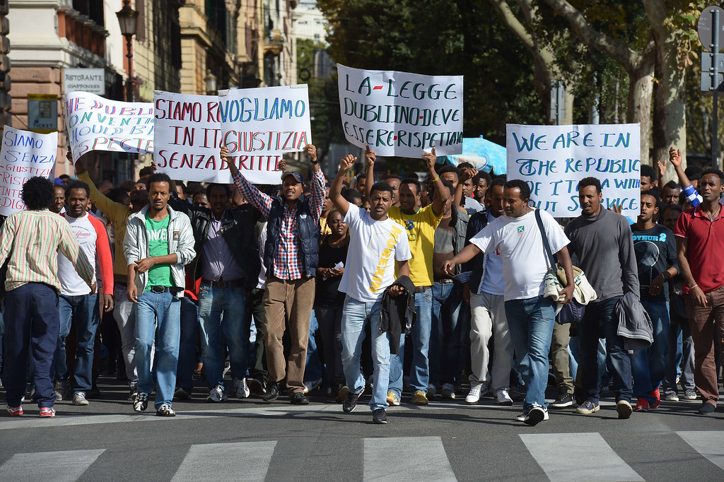 . A group of migrants take part in an anti-austerity protest led by anti high-speed rail movement (No Tav) and an association for rights to housing, on October 19, 2013. ALBERTO PIZZOLI/AFP/Getty Images