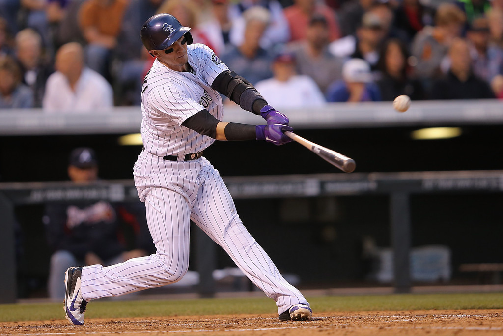 . Troy Tulowitzki #2 of the Colorado Rockies hits an RBI single off of Julio Teheran #49 of the Atlanta Braves to score Josh Rutledge #14 of the Colorado Rockies and take a 5-0 lead in the fifth inning at Coors Field on June 11, 2014 in Denver, Colorado.  (Photo by Doug Pensinger/Getty Images)