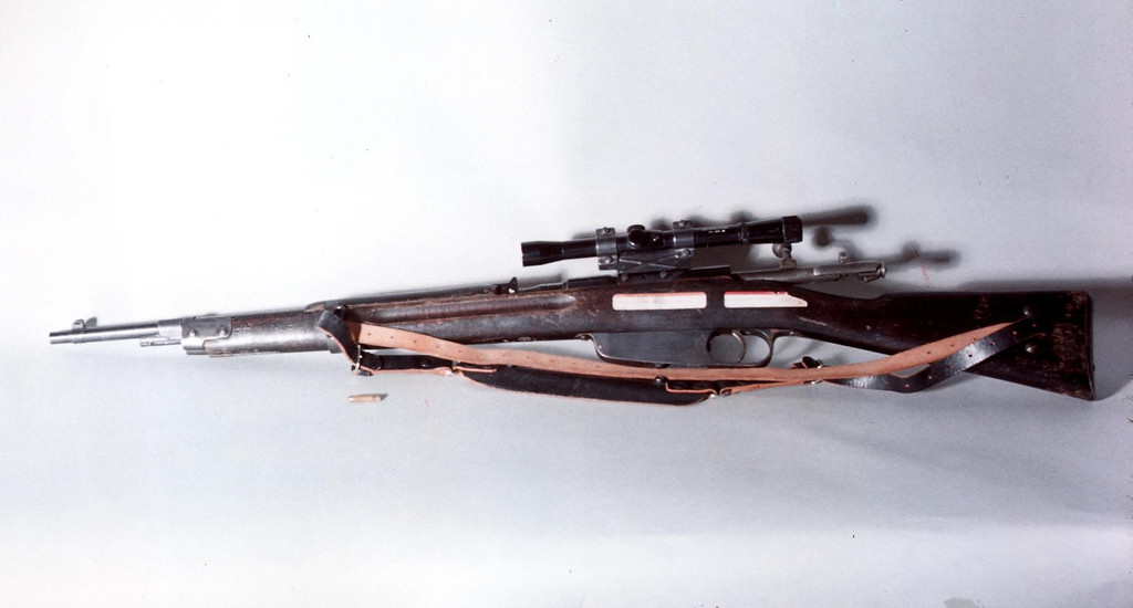 . According to the Warren Commission report, at 1:22 p.m., Dallas police found a Carcano rifle in a staircase leading to the sixth floor of the Texas School Book Depository. Fort Worth Star-Telegram