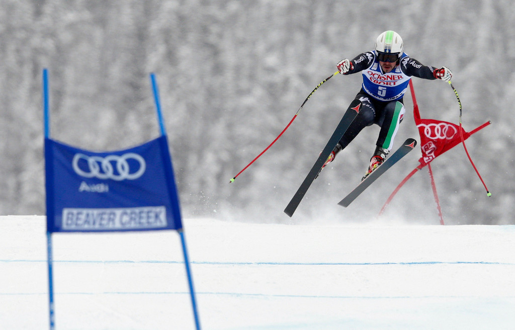 . Italy\'s Peter Fill flies off the Red Tail jump during the men\'s World Cup super-G skiing event, Saturday, Dec. 7, 2013, in Beaver Creek, Colo. Fill took third place behind Switzerland\'s Patrick Kueng and Austria\'s Hannes Reichelt. (AP Photo/ Charles Krupa)