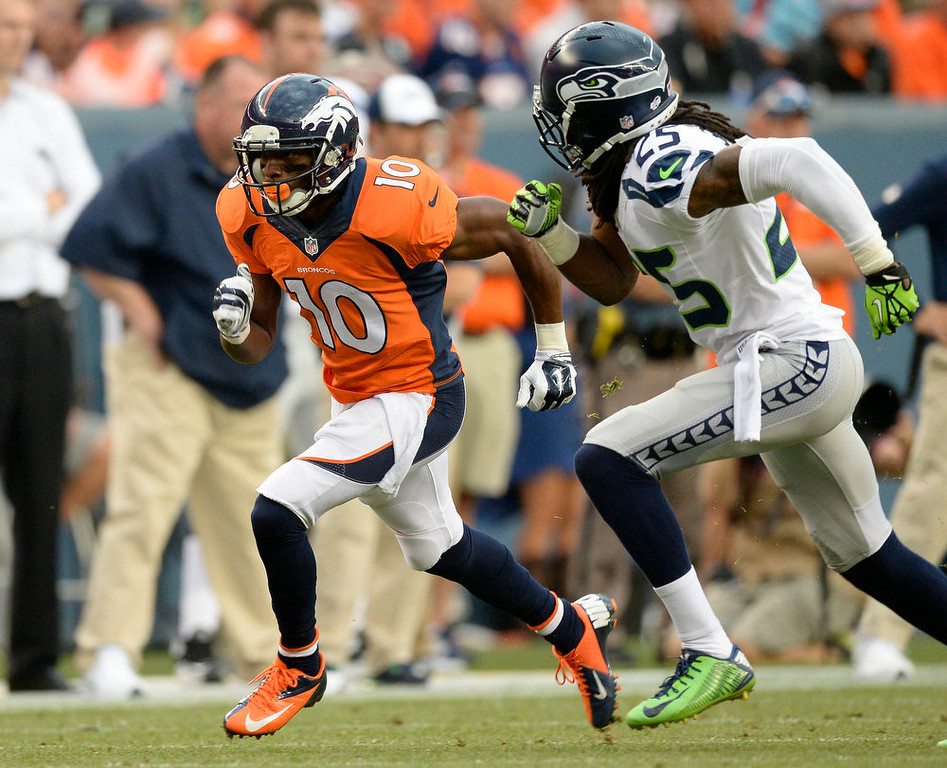 . Wide receiver Emmanuel Sanders (10) of the Denver Broncos gets past cornerback Richard Sherman (25) of the Seattle Seahawks during the first quarter August 7, 2014 at Sports Authority Field at Mile High Stadium.  (Photo by John Leyba/The Denver Post)