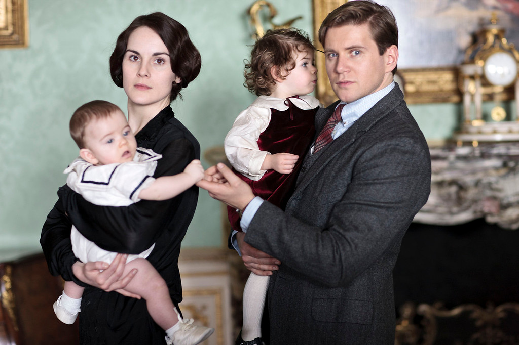 """. Lady Mary and Branson with the children. The fourth season of \""""Downton Abbey\"""", set in 1922, sees the return of our much loved characters. As they face new challenges, the Crawley family and the servants who work for them remain inseparably interlinked.   (Photo by Nick Briggs/Carnival Films & Television Limited 2013 for MASTERPIECE)"""