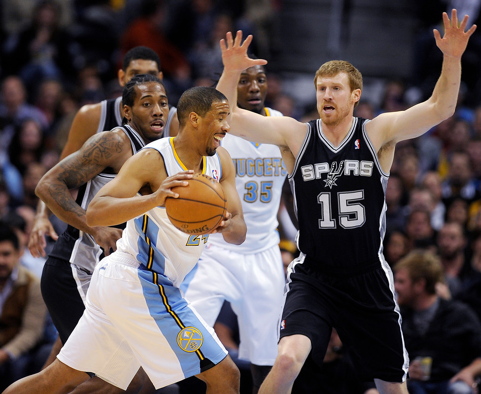 . Andre Miller #24 of the Denver Nuggets attempts to dribble around Matt Bonner #15 and Kawhi Leonard #2 of the San Antonio Spurs during the second quarter at the Pepsi Center on November 5, 2013, in Denver, Colorado. (Photo by Daniel Petty/The Denver Post)